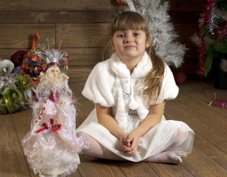 troll dolls: Girl sitting on a floor in New Year room decorated