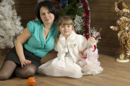 troll dolls: Mother and daughter in room decorated of New Year holiday  Studio work