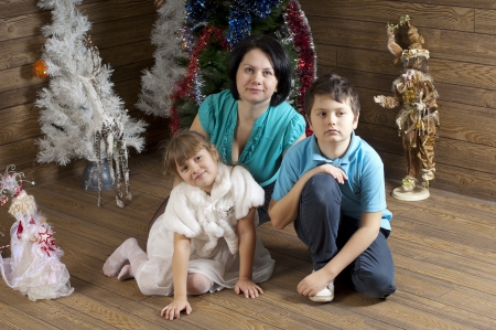 troll dolls: Mother and daughter and son in room decorated of New Year holiday  Studio work Stock Photo
