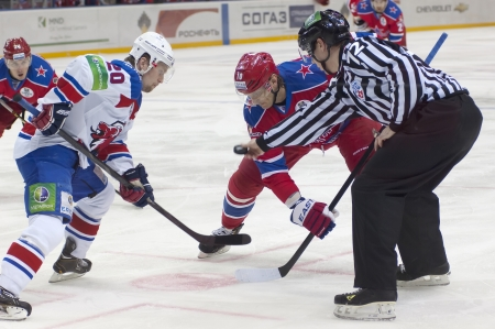 arbiter: MOSCOW - FEBRUARY 20 : Unidentified players on hockey match