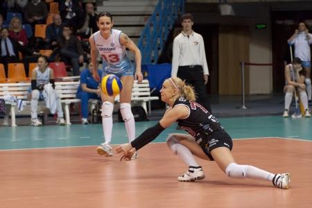 women's volleyball game: MOSCOW, RUSSIA - FEBRUARYMOSCOW, RUSSIA - FEBRUARY 18: M. Marchenko players on womens Rissian volleyball Championship game Dynamo(MSC) vs Omichka(Omsk) on February 18, 2013 in Moscow, Russia 18: Elena Ezhova on women