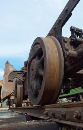 Train old rust weels shot from ground. Industry. Transport concept