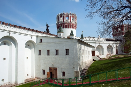 Walls and tower of Novodevichiy Convent in sunny day at summer photo