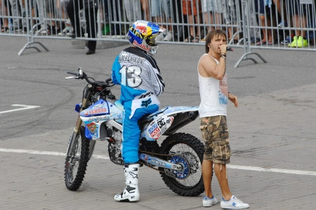 showman: MOSCOW - JULY 13: Number 13, Alexey Kolesnikov and unidentified showman on city event Sport of Moscow passing in Luzhniki, Motofreestile FMX place, on July 13, 2013, in Moscow, Russia