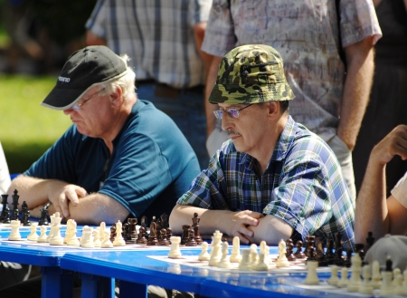 MOSCOW - JULY 13  Unidentified senior men playing chess on city event Sport of Moscow passing in Luzhniki, on July 13, 2013, in Moscow, Russia