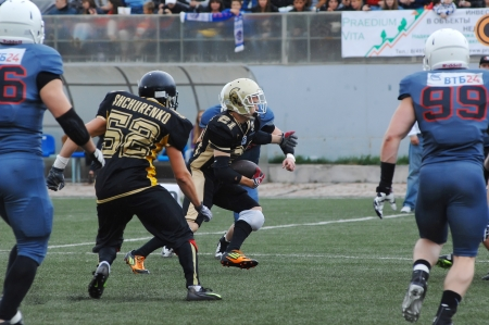 RUSSIA, PODOLSK CITY - JULY 27  K  Shchurenko  52  in action on friendship football game Spartans vs Vityazi on July 27, 2013, in Moscow region, Podolsk city, Russia Stock Photo - 21310092