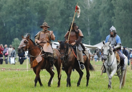RUSSIA, MOLODI VILLAGE - JULY 27  Unidentified people ride the horses on event dedicated to Victory in battle near the Molodi village 1572, on July 27, 2013, in Moscow region, Russia Editorial