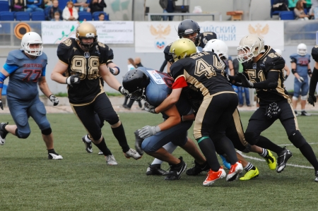 RUSSIA, PODOLSK CITY - JULY 27  S  Merja  44  defends on friendship football game Spartans vs Vityazi on July 27, 2013, in Moscow region, Podolsk city, Russia