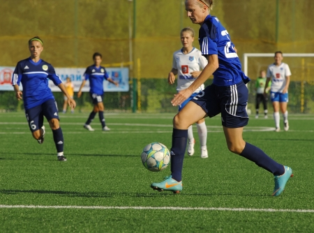 MOSCOW - AUGUST 18  Forward Chub Yana  22  in action  on game Kubanochka vs CSP Izmailovo on Russian tournament of wemen football league on August 18, 2013, in Moscow, Russia