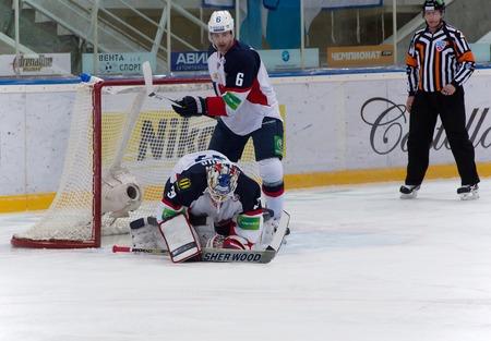 janus: MOSCOW - JANUARY 28, 2014: Janus Jaroslav (32) goaltender of Slovan team catch a puck during the KHL hockey match Dynamo Moscow vs Slovan Bratislava in sport palace Luzhniki in Moscow, Russia. Final score 2:3
