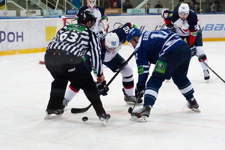 MOSCOW - JANUARY 28, 2014: Radivojevic Branko (92) vs Yuriy Babenko (12) on faceoff during the KHL hockey match Dynamo Moscow vs Slovan Bratislava in sport palace Luzhniki in Moscow, Russia. Final score 2:3