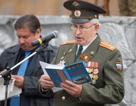 speach: RUSSIA, BORODINO - OCTOBER 12: Guards Colonel V. Kosarev speach on reenactment of the battle in WWII near the Borodino village in 1941, in Moscow region, Borodino, on 12 October, 2014, Russia
