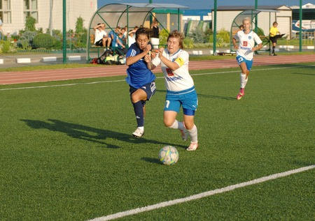 MOSCOW - AUGUST 18: Simakina N. (87,W) vs Kostanyan G. (19,B)  on game Kubanochka vs CSP Izmailovo on Russian tournament of wemen football league on August 18, 2013, in Moscow, Russia
