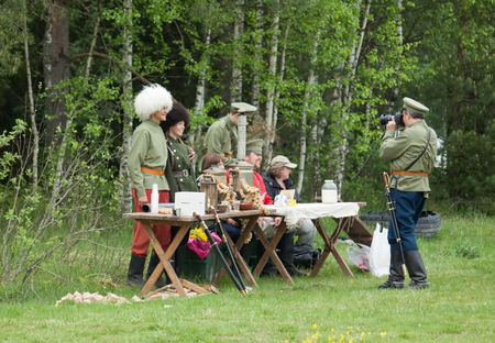 squad: RUSSIA, CHERNOGOLOVKA - MAY 17: Kornilovs hiking squad passing by on History reenactment of battle of Civil War in 1914-1919 on May 17, 2014, Russia Editorial