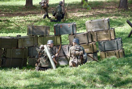 initiatives: ELECTROUGLI CITY - MAY 9: Firing point witn german soldiers during reenactment of the last battle in WWII on celebration dedicated to The Victory day in World War II. This action created and shown by initiatives of Garnizon-A reenactment history club in M