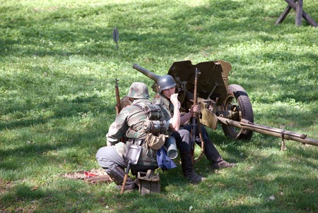 initiatives: ELECTROUGLI CITY - MAY 9: Cannon squad in action during reenactment of the last battle in WWII on celebration dedicated to The Victory day in World War II. This action created and shown by initiatives of Garnizon-A reenactment history club in Moscow regio Editorial