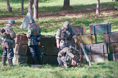 initiatives: ELECTROUGLI CITY - MAY 9: German soldiers took firing positions during reenactment of the last battle in WWII on celebration dedicated to The Victory day in World War II. This action created and shown by initiatives of Garnizon-A reenactment history club