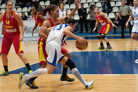 maccabi: MOSCOW - DECEMBER 4, 2014: Irina Sokolovskaya (13) in action during the International Europe bascketball league match Dynamo Moscow vs Maccabi Ashdod Israel in sport palace Krilatskoe, Moscow, Russia. Dynamo loss 59:67