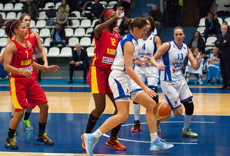 ashdod: MOSCOW - DECEMBER 4, 2014: A. Petrakova (31) and L. Jackson (12) in action during the International Europe bascketball league match Dynamo Moscow vs Maccabi Ashdod Israel in sport palace Krilatskoe, Moscow, Russia. Dynamo loss 59:67