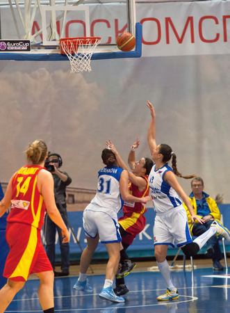ashdod: MOSCOW - DECEMBER 4, 2014: A. Petrakova (31) and I. Sokolovskaya (13) under the basket during the International Europe bascketball league match Dynamo Moscow vs Maccabi Ashdod Israel in sport palace Krilatskoe, Moscow, Russia. Dynamo loss 59:67