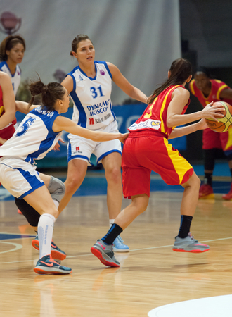 maccabi: MOSCOW - DECEMBER 4, 2014: A. Petrakova (31) and k. Selwyn (5) in action during the International Europe bascketball league match Dynamo Moscow vs Maccabi Ashdod Israel in sport palace Krilatskoe, Moscow, Russia. Dynamo loss 59:67