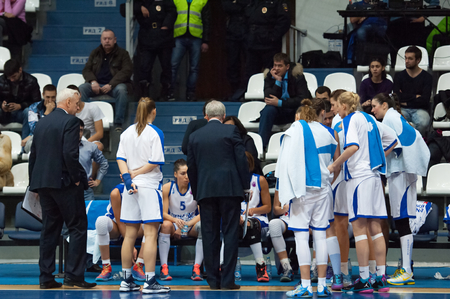 ashdod: MOSCOW - DECEMBER 4, 2014: Dynamo Moscow team on timeout on the International Europe bascketball league match Dynamo Moscow vs Maccabi Ashdod Israel in sport palace Krilatskoe, Moscow, Russia. Dynamo loss 59:67 Editorial