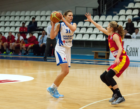 maccabi: MOSCOW - DECEMBER 4, 2014: A. Petrakova (31) versus K. Antic (15) during the International Europe bascketball league match Dynamo Moscow vs Maccabi Ashdod Israel in sport palace Krilatskoe, Moscow, Russia. Dynamo loss 59:67 Editorial