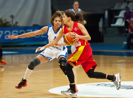 maccabi: MOSCOW - DECEMBER 4, 2014: K. Keyru (4) defense on the International Europe bascketball league match Dynamo Moscow vs Maccabi Ashdod Israel in sport palace Krilatskoe, Moscow, Russia. Dynamo loss 59:67 Editorial