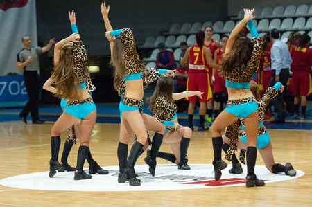 maccabi: MOSCOW - DECEMBER 4, 2014: Cheerleaders dancing during the International Europe bascketball league match Dynamo Moscow vs Maccabi Ashdod Israel in sport palace Krilatskoe, Moscow, Russia. Dynamo loss 59:67 Editorial