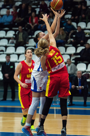 maccabi: MOSCOW - DECEMBER 4, 2014: K. Antic (15) defense during the International Europe bascketball league match Dynamo Moscow vs Maccabi Ashdod Israel in sport palace Krilatskoe, Moscow, Russia. Dynamo loss 59:67