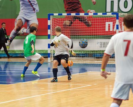MOSCOW - DECEMBER 13: Unidentified players of Slovakia embassy team vs CFIKS team on Minifootball tournament in memoriam Tofik Bahramov on  December 13, 2014, in Krilatskoe stadium, Moscow, Russia