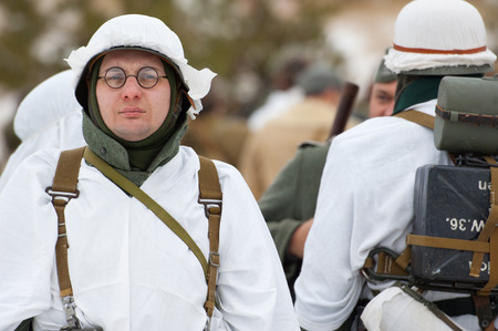german soldier: RUSSIA, LIZLOVO - DECEMBER 14: Unidentified German soldier stand and rest just before reenactment of the counterattack under the Moscow in 1941 in World War II, in Moscow region, Lizlovo village, Russia, 2014