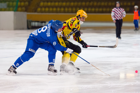 bandy: MOSCOW - DECEMBER 12, 2014: Shamsutov R. (8, b) and Antipov A. (24, y) in action during the Russian  bandy league game Dynamo Moscow vs SKA Neftyanik in sport palace Krilatskoe, Moscow, Russia. Dynamo won 9:1 Editorial