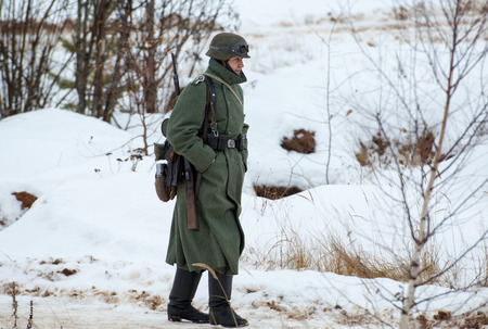 german soldier: RUSSIA, LIZLOVO - DECEMBER 14: Unidentified German soldier walking on reenactment of the counterattack under the Moscow in 1941 in World War II, in Moscow region, Lizlovo village, Russia, 2014 Editorial