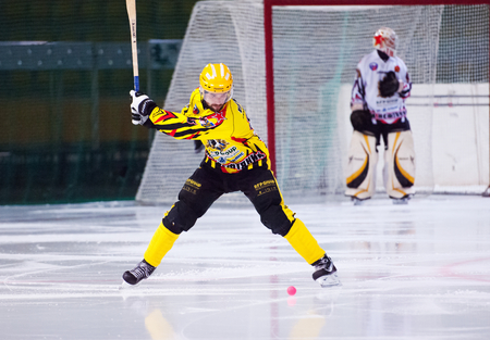 arbiter: MOSCOW - DECEMBER 12, 2014: Chizhov Alexey (8) starts attack on the Russian  bandy league game Dynamo Moscow vs SKA Neftyanik in sport palace Krilatskoe, Moscow, Russia. Dynamo won 9:1