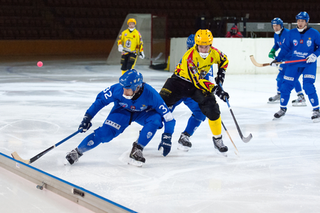 MOSCOW - DECEMBER 12, 2014: Pavel Bulatov (32) in action during the Russian  bandy league game Dynamo Moscow vs SKA Neftyanik in sport palace Krilatskoe, Moscow, Russia. Dynamo won 9:1 Editorial