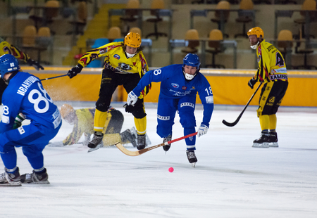 arbiter: MOSCOW - DECEMBER 12, 2014: Shaburov Sergey (18) in action during the Russian  bandy league game Dynamo Moscow vs SKA Neftyanik in sport palace Krilatskoe, Moscow, Russia. Dynamo won 9:1 Editorial