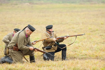 RUSSIA, BORODINO - OCTOBER 12: Unidentified armed seamem shooting on reenactment of the battle in WWII near the Borodino village in 1941, in Moscow region, Borodino, on 12 October, 2014, Russia
