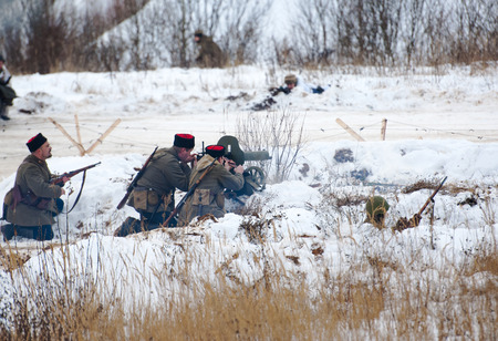 cossacks: RUSSIA, LIZLOVO - DECEMBER 14: Unidentified cossacks fires machine gun on reenactment of the counterattack under the Moscow in 1941 in World War II, in Moscow region, Lizlovo village, Russia, 2014