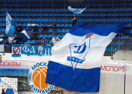 recive: MOSCOW - DECEMBER 4, 2014: Fans on tribune with flags during the International Europe bascketball league match Dynamo Moscow vs Maccabi Ashdod Israel in sport palace Krilatskoe, Moscow, Russia. Dynamo loss 59:67