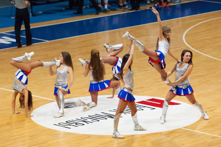 maccabi: MOSCOW - DECEMBER 4, 2014: Unidentified cheerleaders dance during the International Europe bascketball league match Dynamo Moscow vs Maccabi Ashdod Israel in sport palace Krilatskoe, Moscow, Russia. Dynamo loss 59:67