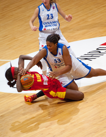 maccabi: MOSCOW - DECEMBER 4, 2014: L. Jackson (12) fall down and fight during the International Europe bascketball league match Dynamo Moscow vs Maccabi Ashdod Israel in sport palace Krilatskoe, Moscow, Russia. Dynamo loss 59:67 Editorial