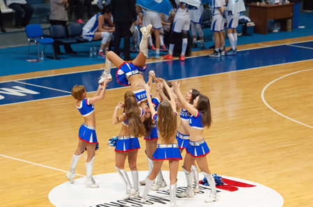 maccabi: MOSCOW - DECEMBER 4, 2014: Unidentified cheerleaders in piramid during the International Europe bascketball league match Dynamo Moscow vs Maccabi Ashdod Israel in sport palace Krilatskoe, Moscow, Russia. Dynamo loss 59:67