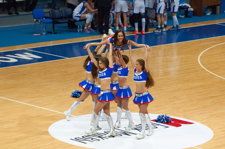 ashdod: MOSCOW - DECEMBER 4, 2014: Unidentified cheerleaders in pyramid during the International Europe bascketball league match Dynamo Moscow vs Maccabi Ashdod Israel in sport palace Krilatskoe, Moscow, Russia. Dynamo loss 59:67 Editorial
