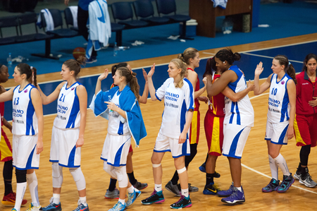 maccabi: MOSCOW - DECEMBER 4, 2014: Unidentified players shakes hands just after International Europe bascketball league match Dynamo Moscow vs Maccabi Ashdod Israel in sport palace Krilatskoe, Moscow, Russia. Dynamo loss 59:67 Editorial