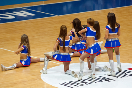 ashdod: MOSCOW - DECEMBER 4, 2014: Unidentified cheerleaders dance on the timeout on the International Europe bascketball league match Dynamo Moscow vs Maccabi Ashdod Israel in sport palace Krilatskoe, Moscow, Russia. Dynamo loss 59:67