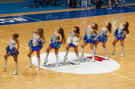 ashdod: MOSCOW - DECEMBER 4, 2014: Unidentified cheerleaders of Dynamo team dance on the timeout on the International Europe bascketball league match Dynamo Moscow vs Maccabi Ashdod Israel in sport palace Krilatskoe, Moscow, Russia. Dynamo loss 59:67 Editorial