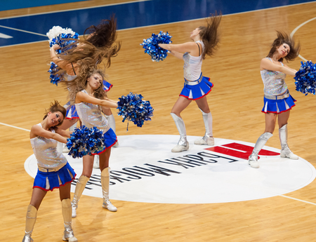 ashdod: MOSCOW - DECEMBER 4, 2014: Unidentified cheerleaders dance during the International Europe bascketball league match Dynamo Moscow vs Maccabi Ashdod Israel in sport palace Krilatskoe, Moscow, Russia. Dynamo loss 59:67