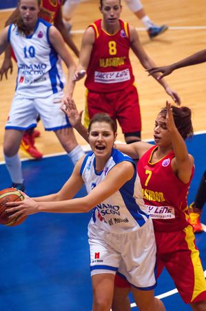 maccabi: MOSCOW - DECEMBER 4, 2014: Anna Petrakova (31) in action during the International Europe bascketball league match Dynamo Moscow vs Maccabi Ashdod Israel in sport palace Krilatskoe, Moscow, Russia. Dynamo loss 59:67 Editorial