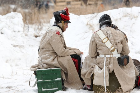 RUSSIA, APRELEVKA - FEBRUARY 7: Unidentified Napoleon war russian soldiers on a rest on reenactment of the Napoleonic maneuvers near the Aprelevka city, in 1812. Moscow region, Aprelevka, 7 February, 2015, Russia